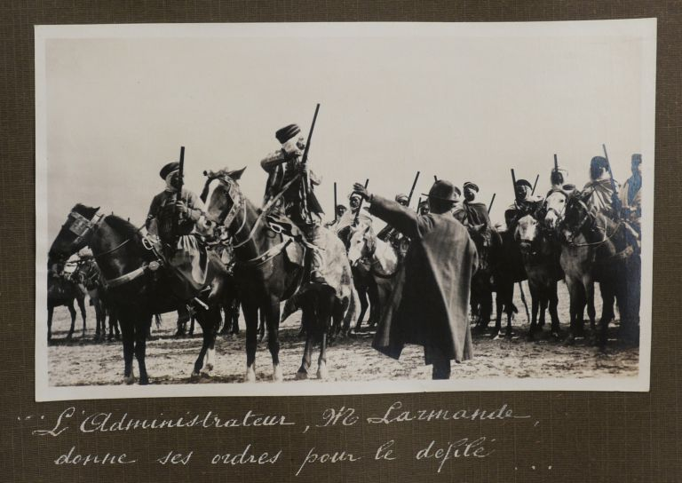 [Album with Fifty-Three Original Gelatin Silver Photographs of a Luncheon and Fantasia (Arab Equestrian Show) Performed for French Spectators near Morsott, Northeastern Algeria, Titled:] Déjeuner et Fantasia Dans la Forêt de Bourlaya / Dimanche 1er Avril 1928. MIDDLE EAST - ALGERIAN FANTASIA.