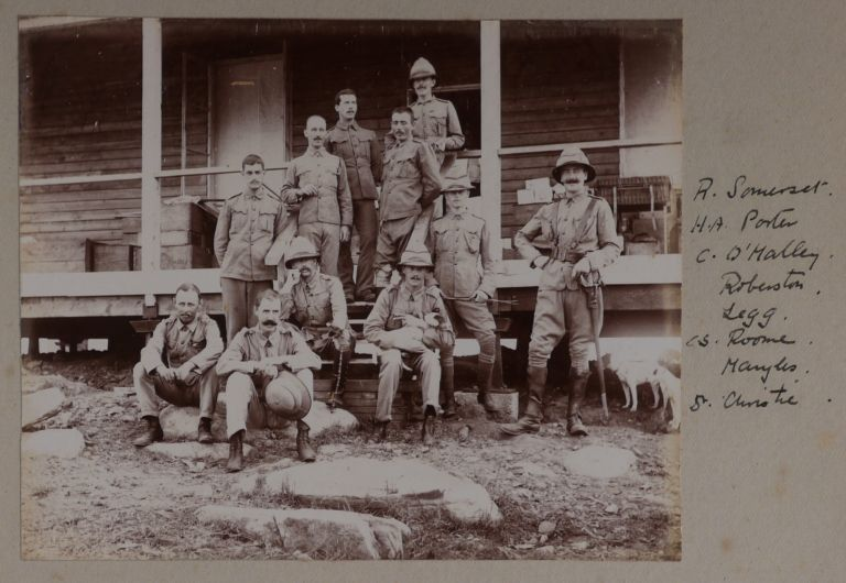 "[Album of 58 Original Gelatin Silver Photographs Showing Commanding Officers and Troops of the West African Frontier Force in Modern-Day Nigeria, Their Headquarters and Camps at Lokoja and Jebba on the Niger River, the Newly Annexed Towns of Kyama, Argeye and Lapai, Officers and Crew of Niger River Naval Steamers ""Heron"" and ""Jackdaw,"" Troops of the River Niger Constabulary, the Three First English Women Who Reached as far as Jebba on the Niger, ""Native Chief and his Suite,"" ""Nupe Canoe men,"" Upper Niger in Dry Season, Villages and People in the Niger Delta, etc.]. AFRICA – NIGERIA – WEST AFRICAN FRONTIER FORCE."