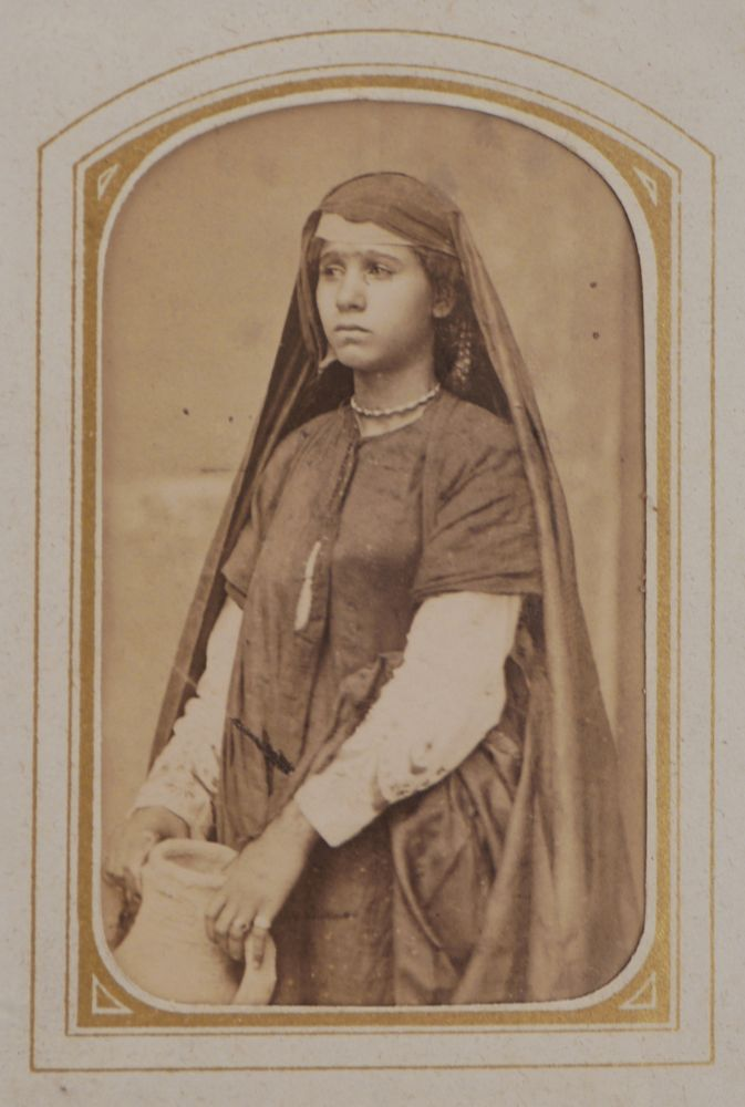 [Album of Thirty-nine Early Original Carte-de-visite Albumen Photograph Portraits of Egyptian People, Views of Cairo, the Great Pyramid of Giza, the Pompey's Pillar in Alexandria, and others]. MIDDLE EAST - EGYPT, Louis de MICHELE, Emile BÉCHARD, Hippolyte DÉLIÉ, fl. 1860s-1880s, fl. 1870s.
