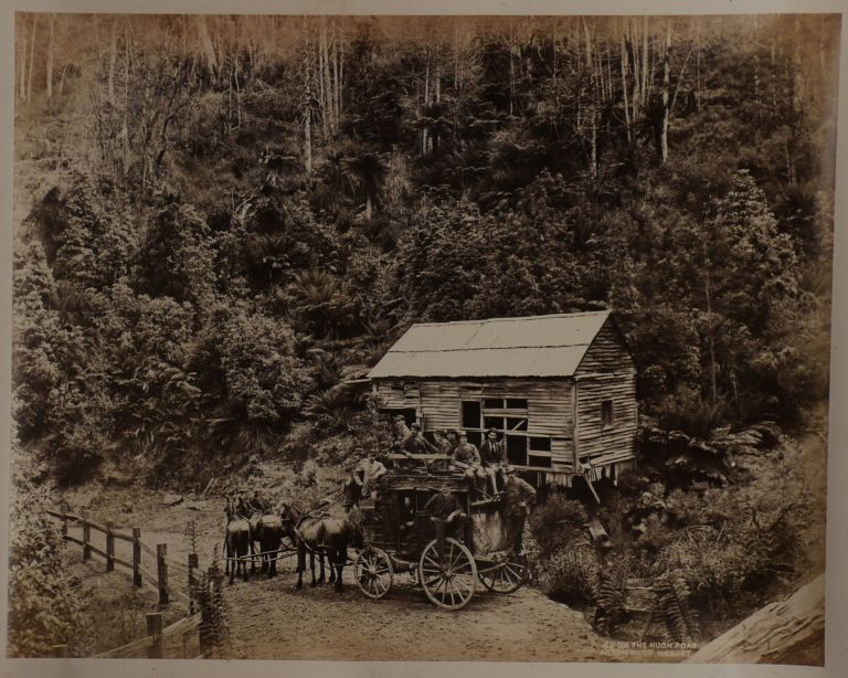 [Album with Thirty-seven Large Original Albumen Photos of Tasmania, Showing Engines and Carriages of the Tasmanian Main Line Railway, Three Important Photos of the 1886 Bridgewater Train Accident, Walter Webster's Royal Mail Coach on the Huon Road, Views of Hobart, Launceston, New Town, Sandy Bay, Mount Bischoff Tin Mine, Huon River Bridge, Sorell Causeway, Salmon Ponds on the Derwent River, Launceston Cataract Gorge, and Others]. PACIFIC - TASMANIA, ANSON BROTHERS STUDIO.