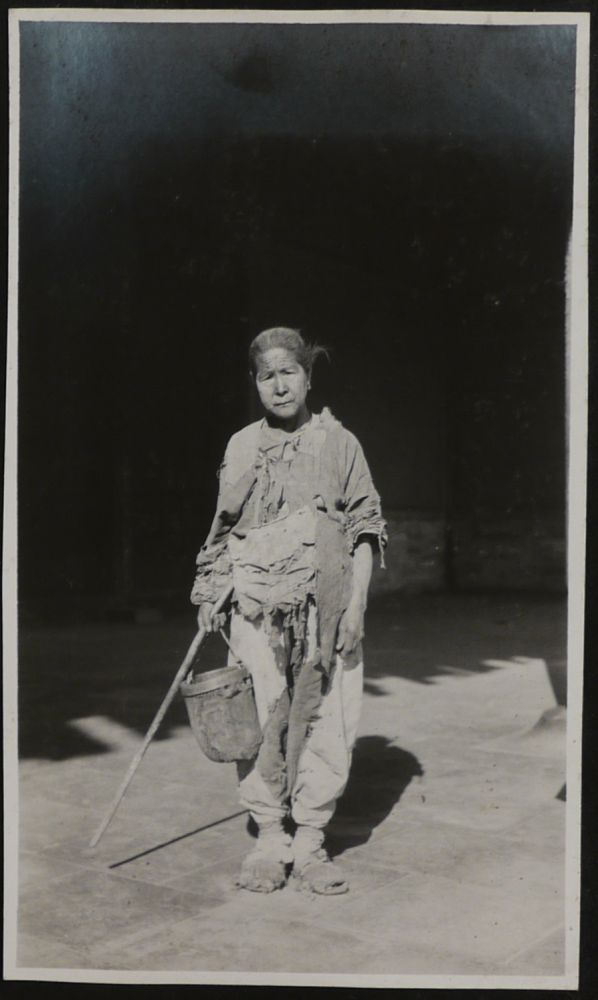 [Album with 111 Original Gelatin Silver Photos of Beijing and Environs, Apparently Taken by an American after the Boxer Rebellion, Including 86 Interesting and Unusual Portraits of Chinese Beggars, Street Sellers, Elders, Peasants, Construction Workers, Families, Monks, Noble Women, Camel Riders; Market and Street Scenes, Views of Beijing Historical Sites etc.]. ASIA - CHINA - BEIJING.