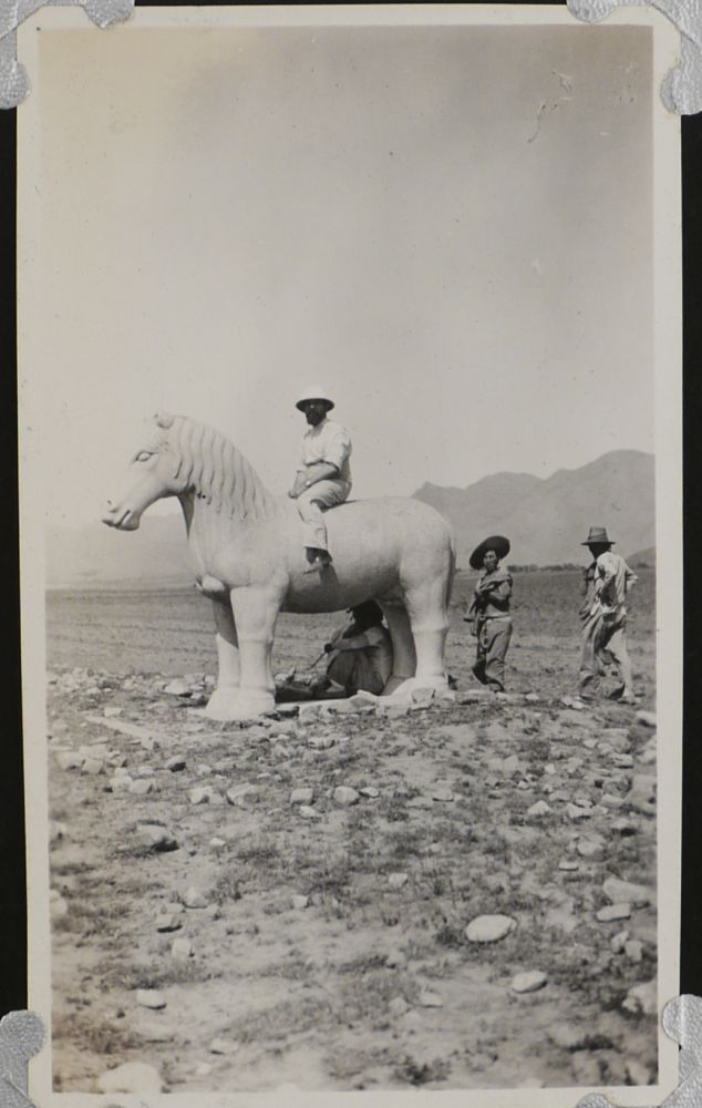 [Album with 233 Original Gelatin Silver Vernacular Photographs,Taken by Likely American Travellers to China in 1920, Showing the Sites of Beijing, the Great Wall of China, the Ming Tombs Overgrown with Grass, a Trip by Railway to Jinan and Japanese-occupied Quingdao, Portraits of Chinese Monks, Soldiers, Children, the Travellers Sitting on Ancient Statues, etc.]. ASIA - CHINA.