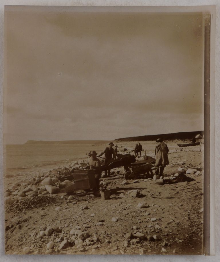 """[Collection of Thirty-Two Original Gelatin Silver Photographs of Alaska and Yukon Territory During the Nome Gold Rush, Including Over Twenty Photos of Nome, Showing Prospectors and Gold Mining Equipment on the Beach, Tent Camps, City Streets and Shops, Piper's Bakery, a Dance Hall, """"Eskimos Nome,"""" etc.]. NORTH AMERICA - ALASKA - NOME GOLD RUSH."""
