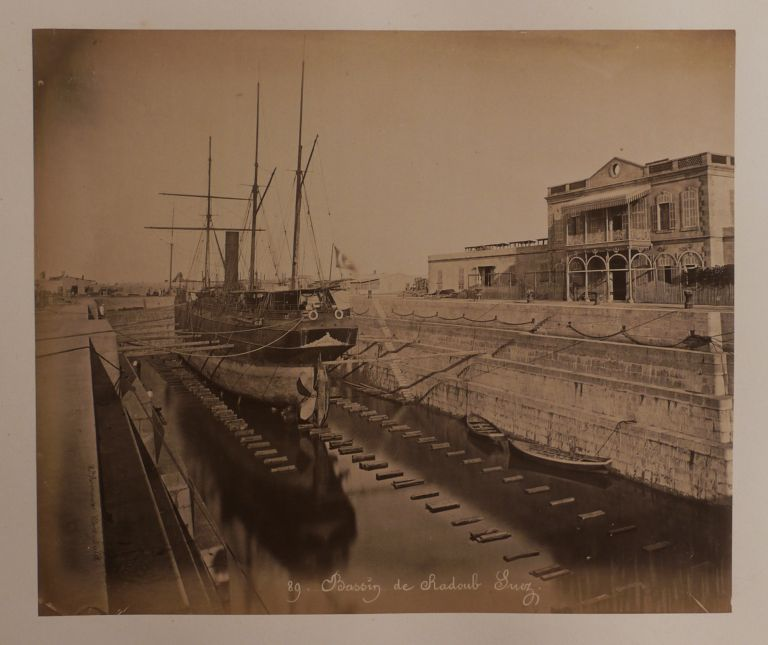 [Album with Twenty-three Large Original Albumen Photographs Including Two Panoramas by Hippolyte Arnoux Showing the Newly Completed Suez Canal (1869) with Views of Port Said and Ismaïlia]. MIDDLE EAST, ISLAMIC WORLD - EGYPT - SUEZ CANAL, active.