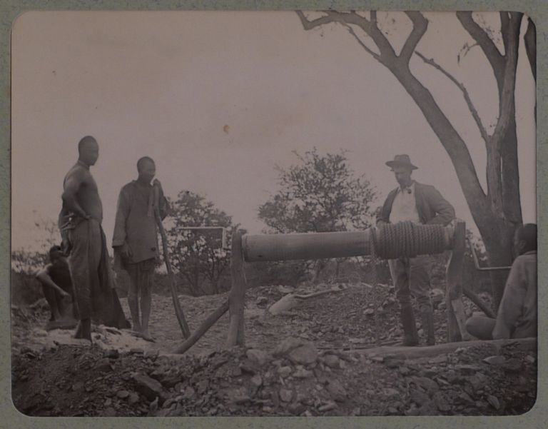 [Album with 108 Original Gelatin Silver Photos of Southern Rhodesia, Showing the Sabiwa and Antenior Gold Mines, Scenes from a Prospecting Expedition to the Sengwe, Omay, and Zambezi Rivers, Views of Bulawayo during the First Election of the Legislative Council in April 1899, Exhibits at the Bulawayo Agricultural Fair, Native Villages, Portraits of Native People, Jack Warwick, J.C. Knapp, Mowbray Farquhar, Miss Cecilia Lawley, and Others]. AFRICA - ZIMBABWE – MINING.