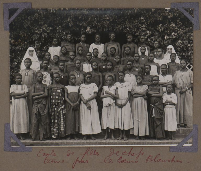 [Album with Fifty-One Original Gelatin Silver Photos of the Flourishing Network of Catholic Missions and Schools in the South of the Uganda Protectorate, Showing the Vicar Apostolic of Uganda Henri Streicher, the Founder of the Bwanda Sister's Convent Mother Mechtilde, the First Ugandan Mother Superior Mama Cecilia Nalube, Views of the Bwanda Sister's Convent, Villa Maria Hospital, Portraits of the Nuns, Novitiates and Schoolchildren, Students from the Schools in Kisubi, Kitovu, Nandere, White Fathers in the Mitala Maria Mission, et al.]. AFRICA - UGANDA – CATHOLIC MISSIONS.