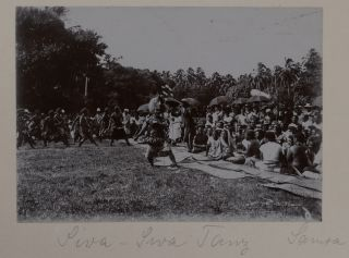 """[Beautiful Lacquered Album with Primarily Ethnographic Content with 87 Original Photographs of German Pacific Colonies and Fiji, Showing Apia, Vailele Plantation, Cape Fatuosofia, traditional Siva Samoa dance, portraits of King Mata'afa Losefo onboard S.M.S. """"Leipzig,"""" German Picnickers at the Fagali'i Falls, Samoan and Fijian People, New Pomeranian Warriors, Native Prisoners from Ponape (the Carolines), Children from a Catholic Mission on Jaluit (Marshall Islands), etc.]"""