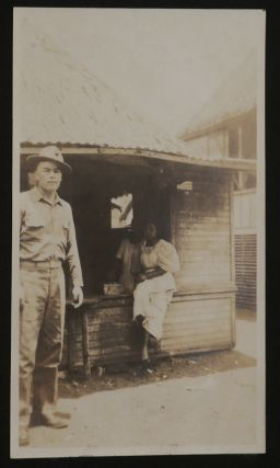 [Album of 154 Original Gelatin Silver Photographs Taken by an American Sailor of the Cavite Navy Yard in the Philippines, with Interesting Informal Portraits of the Sailors, Views of the Yard Facilities, Radio Towers, Ships, Cavite Cabaret, Views of Cavite City, Street Parades, and Portraits of the Filipino People.]