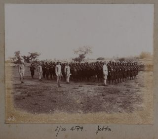 "[Album of 58 Original Gelatin Silver Photographs Showing Commanding Officers and Troops of the West African Frontier Force in Modern-Day Nigeria, Their Headquarters and Camps at Lokoja and Jebba on the Niger River, the Newly Annexed Towns of Kyama, Argeye and Lapai, Officers and Crew of Niger River Naval Steamers ""Heron"" and ""Jackdaw,"" Troops of the River Niger Constabulary, the Three First English Women Who Reached as far as Jebba on the Niger, ""Native Chief and his Suite,"" ""Nupe Canoe men,"" Upper Niger in Dry Season, Villages and People in the Niger Delta, etc.]"