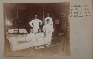 """[Album of 58 Original Gelatin Silver Photographs Showing Commanding Officers and Troops of the West African Frontier Force in Modern-Day Nigeria, Their Headquarters and Camps at Lokoja and Jebba on the Niger River, the Newly Annexed Towns of Kyama, Argeye and Lapai, Officers and Crew of Niger River Naval Steamers """"Heron"""" and """"Jackdaw,"""" Troops of the River Niger Constabulary, the Three First English Women Who Reached as far as Jebba on the Niger, """"Native Chief and his Suite,"""" """"Nupe Canoe men,"""" Upper Niger in Dry Season, Villages and People in the Niger Delta, etc.]"""