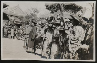 [Album with 111 Original Gelatin Silver Photos of Beijing and Environs, Apparently Taken by an American after the Boxer Rebellion, Including 86 Interesting and Unusual Portraits of Chinese Beggars, Street Sellers, Elders, Peasants, Construction Workers, Families, Monks, Noble Women, Camel Riders; Market and Street Scenes, Views of Beijing Historical Sites etc.].