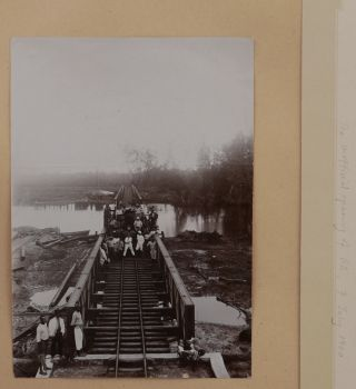 [Album with 42 Original Photographs of Construction and the First Years of Sierra Leone Government Railway; [With] a Printed Address Broadside from the SLGR Staff to the Sierra Leone Governor Commemorating the Opening of the Railway's First Section; With a 1901 Christmas Card Decorated with a Photo Portrait of the Album's Compiler and a Photo of His Bungalow]