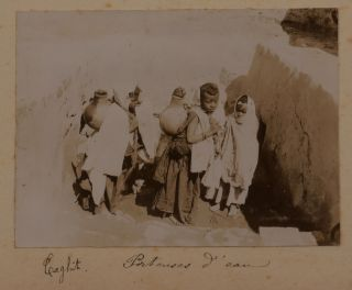 [Collection of Two Albums with 128 Original Gelatin Silver Photos Taken by a French Participant of the South-Oranese Campaign in Southwestern Algeria, Showing Towns and Military Posts (Taghit, Béni Abbès, Mazzer, Igli, Kerzaz, Tamtert, Béni Ounif, Duveyrier, Ain Sefra, Saida), Native Ksars, Military Convoys, Wounded French Military Men, Funeral and Exhumation of French Officers, Captured Berbers, Hermitage of a Catholic Hermit Charles de Foucauld, Scenes of Vaccination by Dr. Perrin, Portraits of the Local People, etc.]