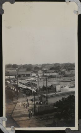 [Album with 233 Original Gelatin Silver Vernacular Photographs,Taken by Likely American Travellers to China in 1920, Showing the Sites of Beijing, the Great Wall of China, the Ming Tombs Overgrown with Grass, a Trip by Railway to Jinan and Japanese-occupied Quingdao, Portraits of Chinese Monks, Soldiers, Children, the Travellers Sitting on Ancient Statues, etc.].
