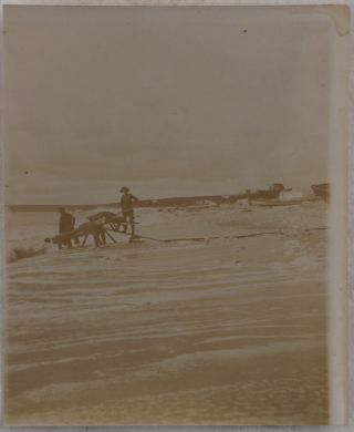 """[Collection of Thirty-Two Original Gelatin Silver Photographs of Alaska and Yukon Territory During the Nome Gold Rush, Including Over Twenty Photos of Nome, Showing Prospectors and Gold Mining Equipment on the Beach, Tent Camps, City Streets and Shops, Piper's Bakery, a Dance Hall, """"Eskimos Nome,"""" etc.]"""