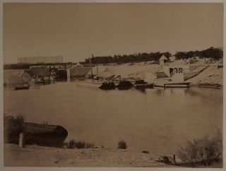 [Album with Twenty-three Large Original Albumen Photographs Including Two Panoramas by Hippolyte Arnoux Showing the Newly Completed Suez Canal (1869) with Views of Port Said and Ismaïlia].