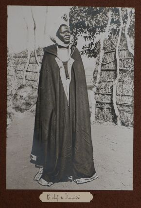[Album with 146 Original Gelatin Silver Photographs from the Mission to Delineate the Border Between French Congo and German Cameroon in 1905-1907, Including Excellent Early Portraits of Native People from Modern-Day Central Africa Republic (M'Biemou, Pande, Baya/Gbaya), M'Boum, Labbi), East Cameroon (Bororo, and Chad (Laka, Mundang, Toubouri); Views of Gaza, Kounde, Lere, Chari River, Lake Chad, Benue River, Scenes of Dancing, Playing tam-tams, Throwing knife contest; the court of the ruler in Ngaoundere, Baya and Mundang cavalry, warriors, Baya witch-doctor; details of costumes, hairdos, and scarification etc.]