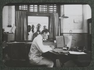 """[Collection of Four Albums with 254 Original Gelatin Silver Photos of German East Africa (Tanzania and Rwanda), Taken by German Post Inspector Leopold Oehler While in Service in Dar es Salaam; With Oehler's Large Photograph Portrait, Travel Passport, Two Postal Receipts from Istanbul, a Leaf of Pencil Notes with the Printed Letterhead of """"Kaiserlich Deutsches Postamt, Dar-es-Salaam,"""" and a Notebook with Over 100 pages of Carbon Copies of Oehler's Letters and Diary Notes Written During his Time in German East Africa]."""